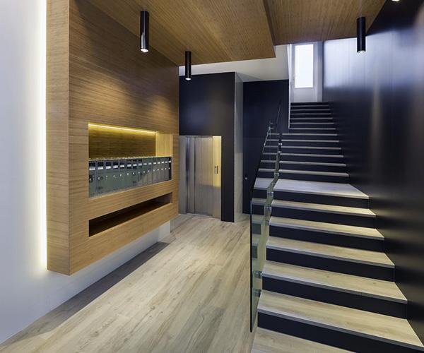 Bajada cota cero ascensor reforma portal calle Felipe II Valladolid